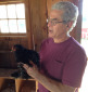 Dr. Steve Katz examines Tilly Foster Farm's young rooster, Walker.
